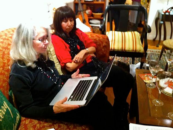 "Members of the ""Westside Bookies"" Book Club, Los Angeles, California, skyping Carmen Rodriguez during the meeting in which they discussed Retribution. December, 2013."